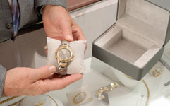 jeweler holding fine watch