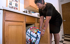 Woman with recycling bag in apartment kitchen