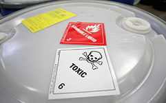 Drum with hazardous waste stickers
