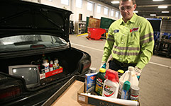 Unloading household hazardous waste at drop-off facility