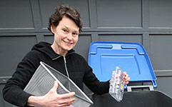 Woman emptying items into recycling bin