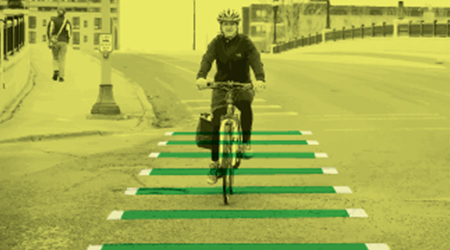 Dashed green line on bike lanes image