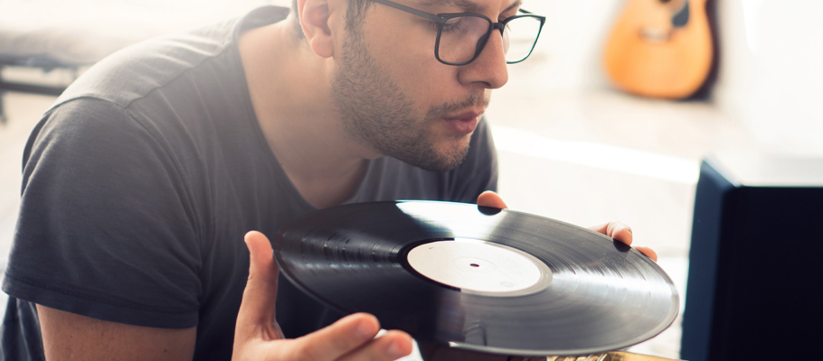 Man inspecting the quality of a vinyl record
