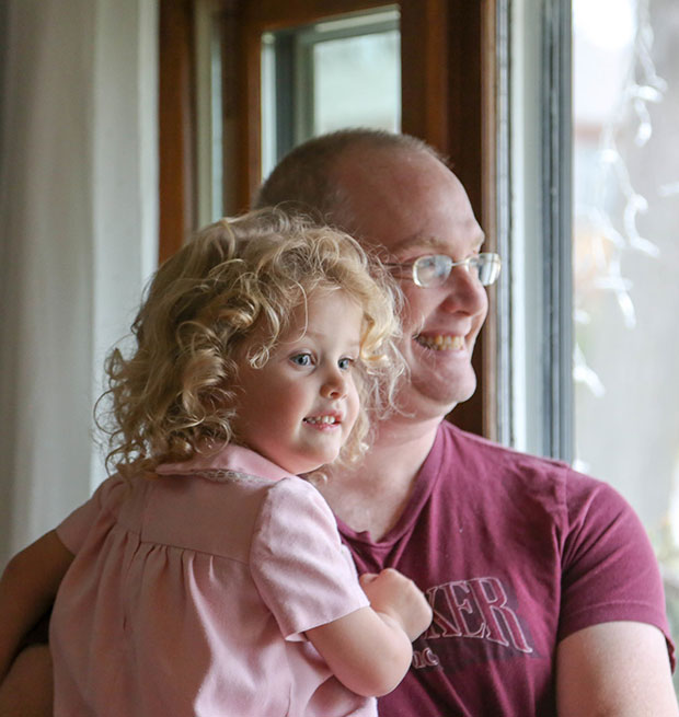 dad and daughter looking out window