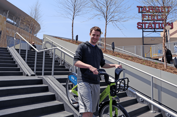 A photo of a visitor using the bike path feature in the middle of the staircase.