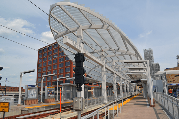 A photo of the big round canopy that protects the train and passengers.