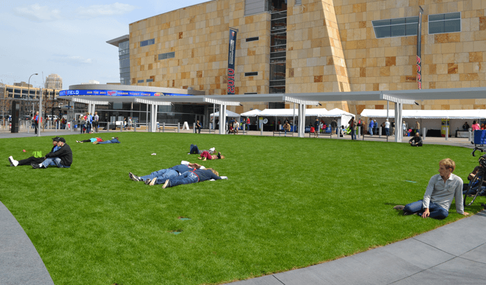 A photo of people enjoying the large outdoor green space.
