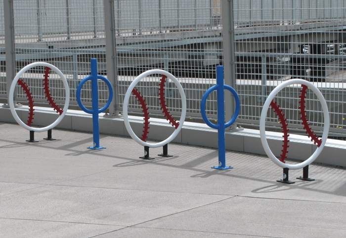 A photo of the creative racks for riders to lock their bikes onto.
