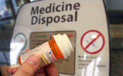 Pill bottle at medicine disposal box