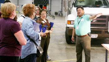 presenter talking with group at Public Works facility