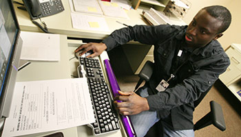 Volunteer working at desk