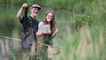 Volunteers studying wetland plants